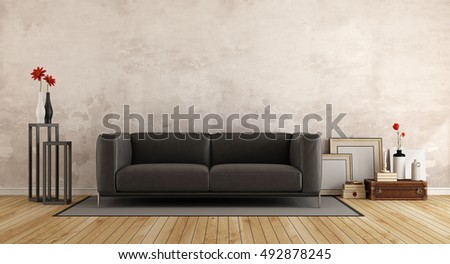 Black modern sofa in a living room with old wall and retro objects - 3d rendering
