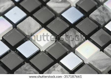 Black mosaic texture. Glass and stone.