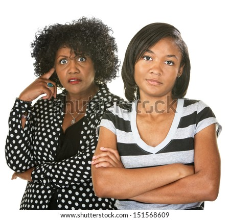 Black mother with teenage daughter on isolated background - stock photo