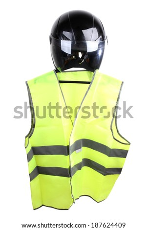 Black motorcycle helmet and vest on a white background - stock photo
