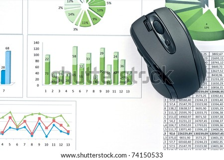Black mouse on a stock chart. Studio shot - stock photo