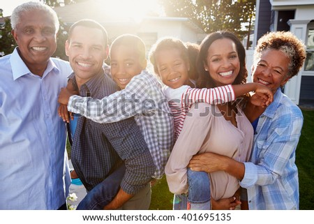 Black multi generation family outside, backlit portrait - stock photo