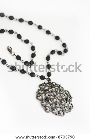 Black necklace isolated on white - stock photo