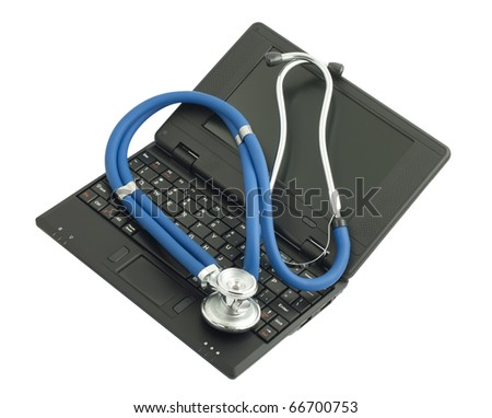 Black netbook and medical stethoscope on white background