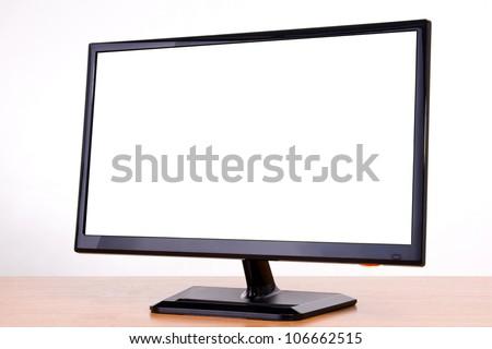 black new monitor on white background in studio - stock photo