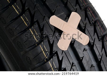 black new tire with patch on white background - stock photo