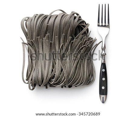 black noodles with squid sepia ink and fork on white background - stock photo