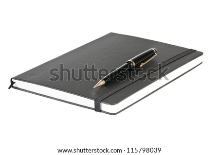 Black notebook and pen over a white background - stock photo