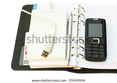 Black notebook, pen, mobile phone and External Hard Drive good gift for the businessman. White background.