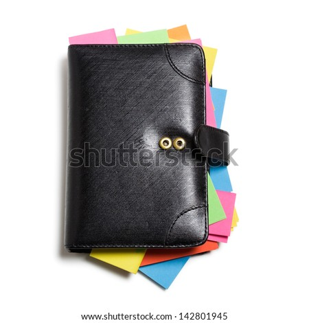 Black notebook with colorful note papers on white background, clipping path included - stock photo