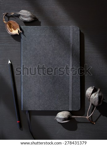 black notes on a black table - stock photo
