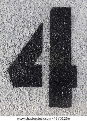 Black number four painted on the asphalt - stock photo