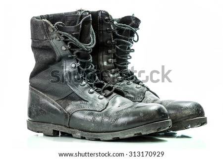 Black old combat military boots isolated on white background - stock photo