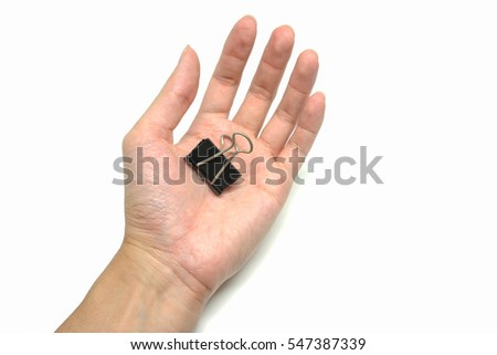 Black old metal binder paper clip for document in hand isolated on white background for add some text