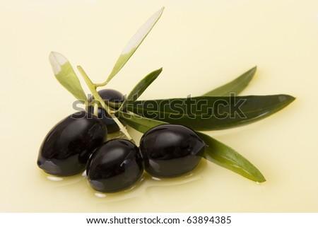 Black olive in olive oil - stock photo
