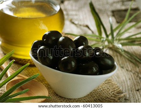 Black Olives and Virgin Olive Oil - stock photo