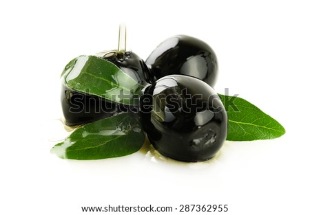Black olives in oil on a white background. - stock photo