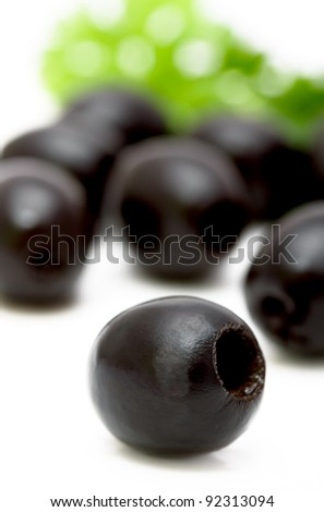 black olives on a plate closeup, focus on foreground - stock photo