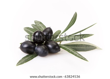 Black olives with leaves isolated on white - stock photo