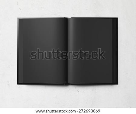 black open book on white concrete. 3d render - stock photo