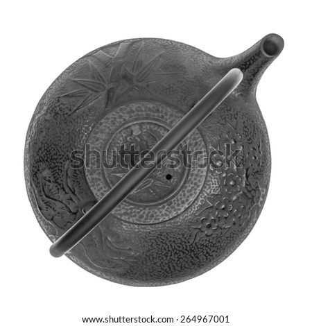 Black oriental teapot isolated on white background, overhead view - stock photo