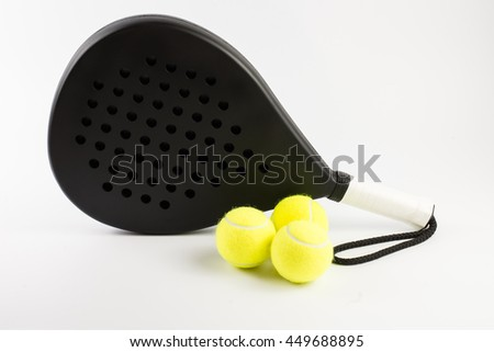 Black padel racket with balls - stock photo