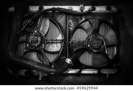 Black painted cooling system of an old car.