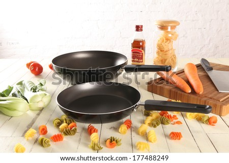 Black pan over wood - stock photo