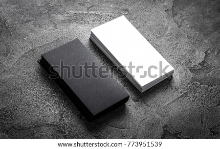 Black paper business card template on grey background. Blank name card for text space.