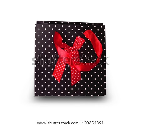 Black paper gift bag cut out on white background