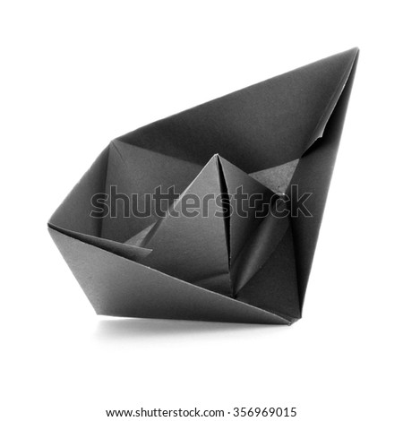 Black paper navigation origami sail boat, isolated on white background - stock photo