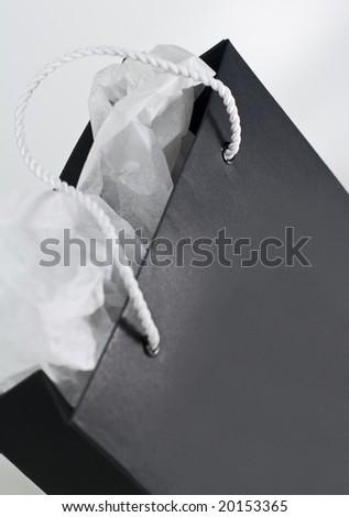 black paper shopping bag close up - stock photo