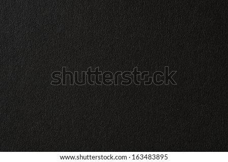 Black paper texture or background  - stock photo