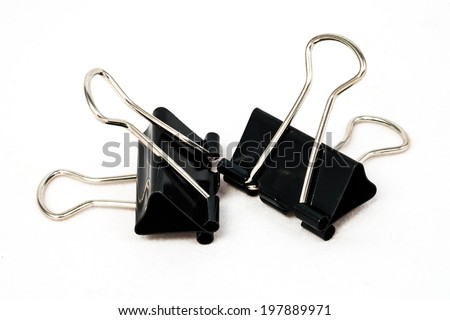 Black paperclip in white background - stock photo
