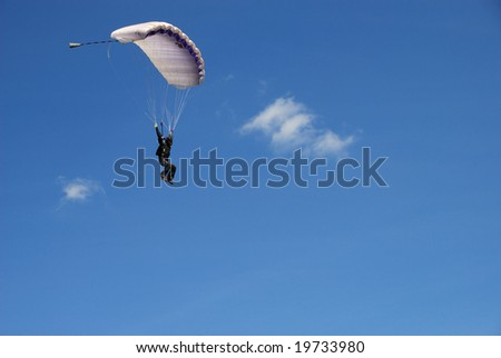 Black paratrooper just before landing with space for text