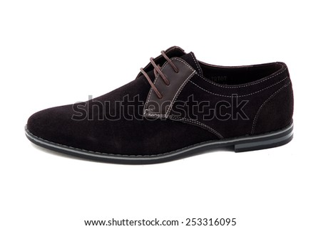 Black patent leather men shoes against white background. Male fashion with shoes on white.  The black man's shoes isolated on white background. - stock photo