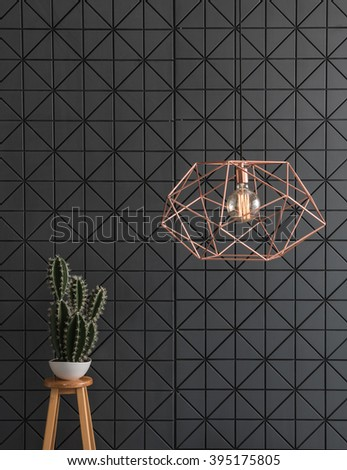 black pattern wall  interior with modern copper lamp and stool  - stock photo
