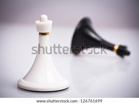 Black pawn defeated by white pawn