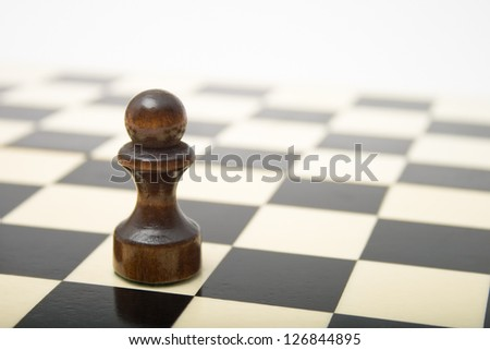 Black Pawn on a chess board - stock photo