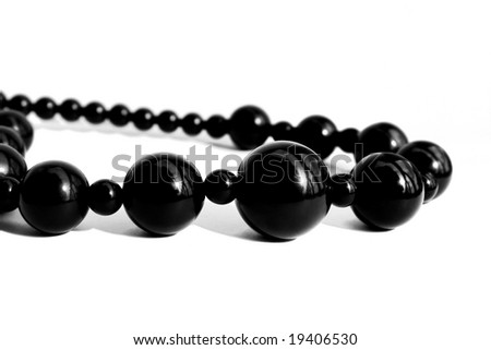 Black pearl necklace isolated on white background - stock photo