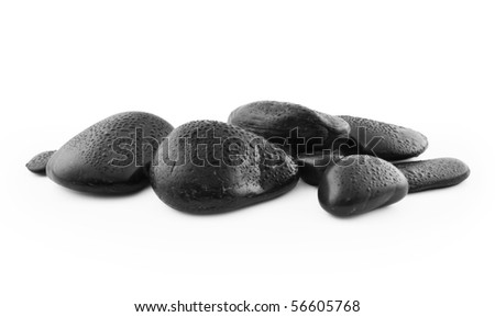 Black pebble stones isolated on white background, Clipping path included.