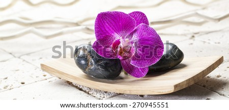 black pebbles for relaxation and massage - stock photo