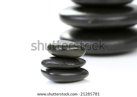 black pebbles isolated on white - health and beauty