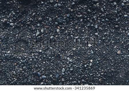 black pebbles patterned texture wallpaper - stock photo