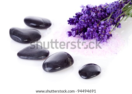 black pebbles stones and lavender flowers over white background