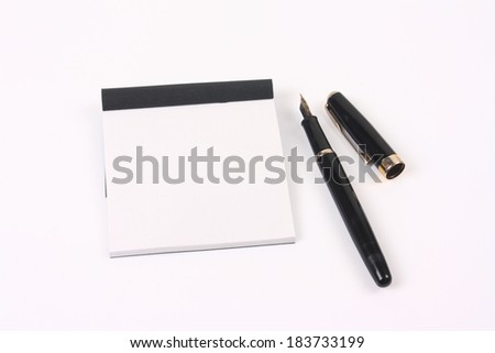 Black pen and note - stock photo