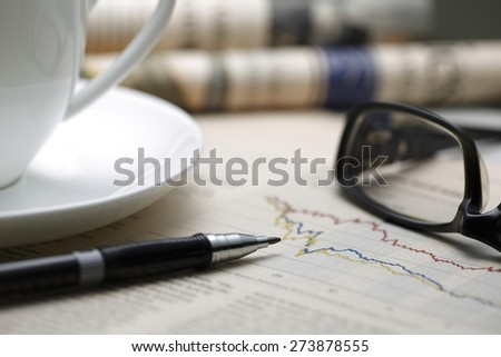 Black pen with financial figures and Glasses,shot with very shallow depth of field. - stock photo