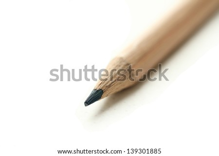 black pencil diagonal isolated - stock photo