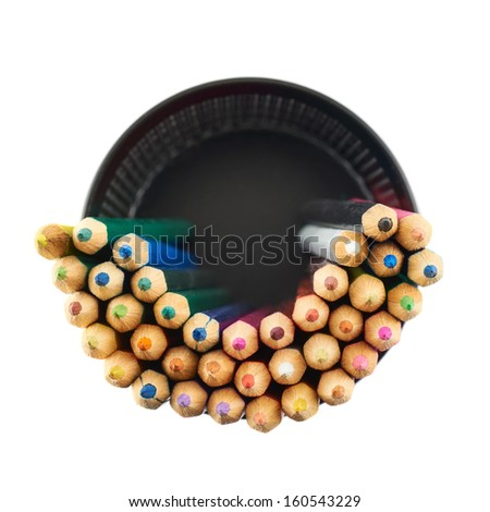 Black pencil holder full of colorful pencils, top view above, isolated over white background - stock photo