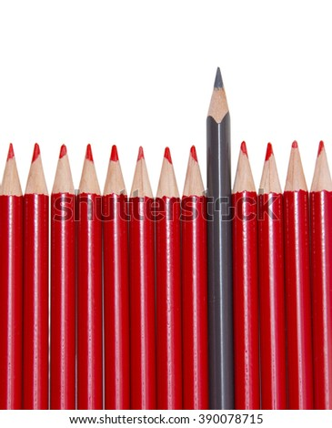 Black pencil standing out from the red pencils, isolated - stock photo